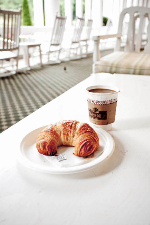 Relaxing on the porch with a cup of coffee and croissant from from Martha's Market.
